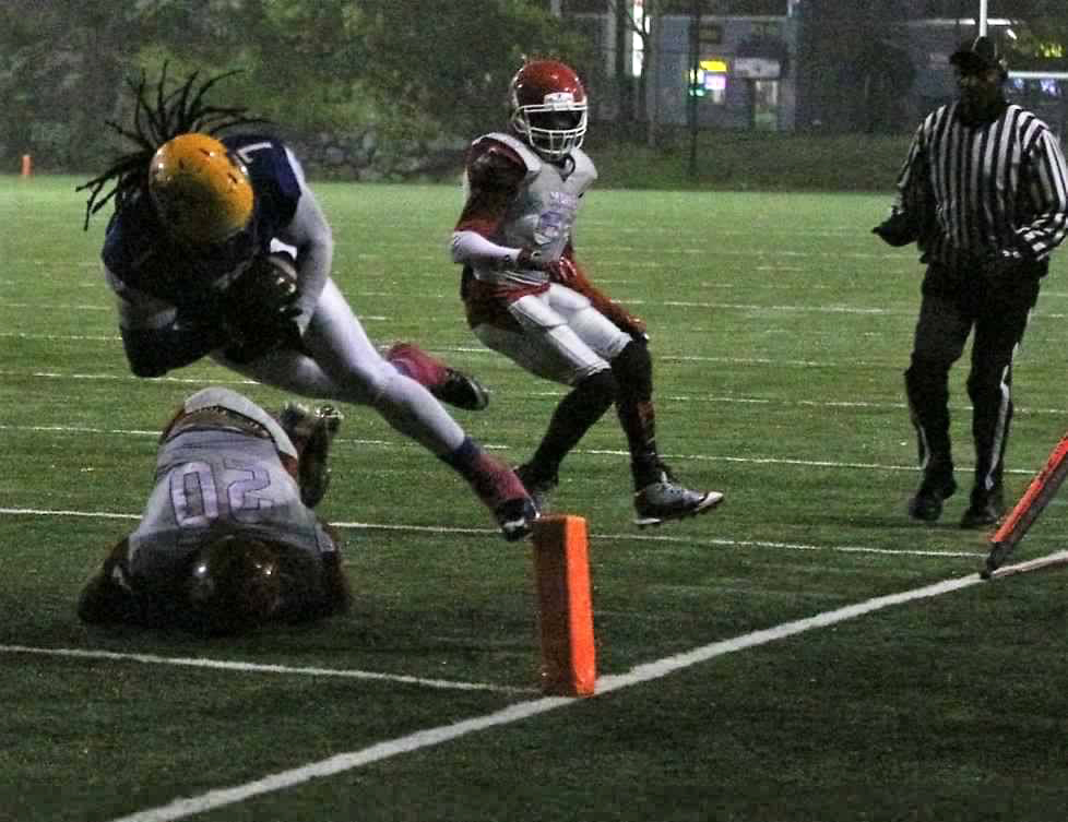 Boston's Shane Cheltenham dives into the endzone after catching a pass from Clarzell Pearl. (Photo courtesy of winnersdna.com)
